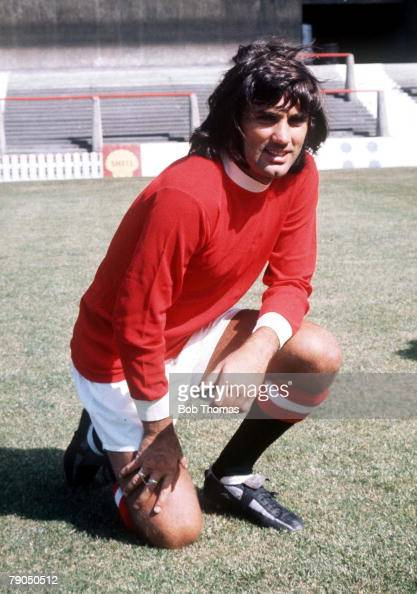 Football Manchester United footballer George Best poses in the club strip at Old Trafford