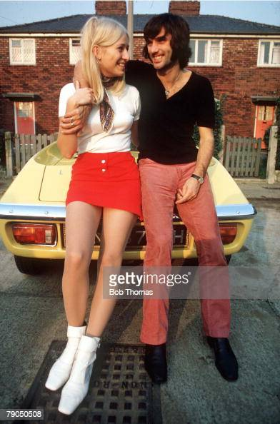 Football Manchester United star George Best poses with former fiancee Eva on Best's Lotus Elan car