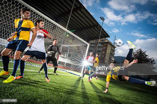 match de Football au stadium: Ciseau retourné