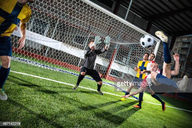 Football match in stadium: Bicycle kick