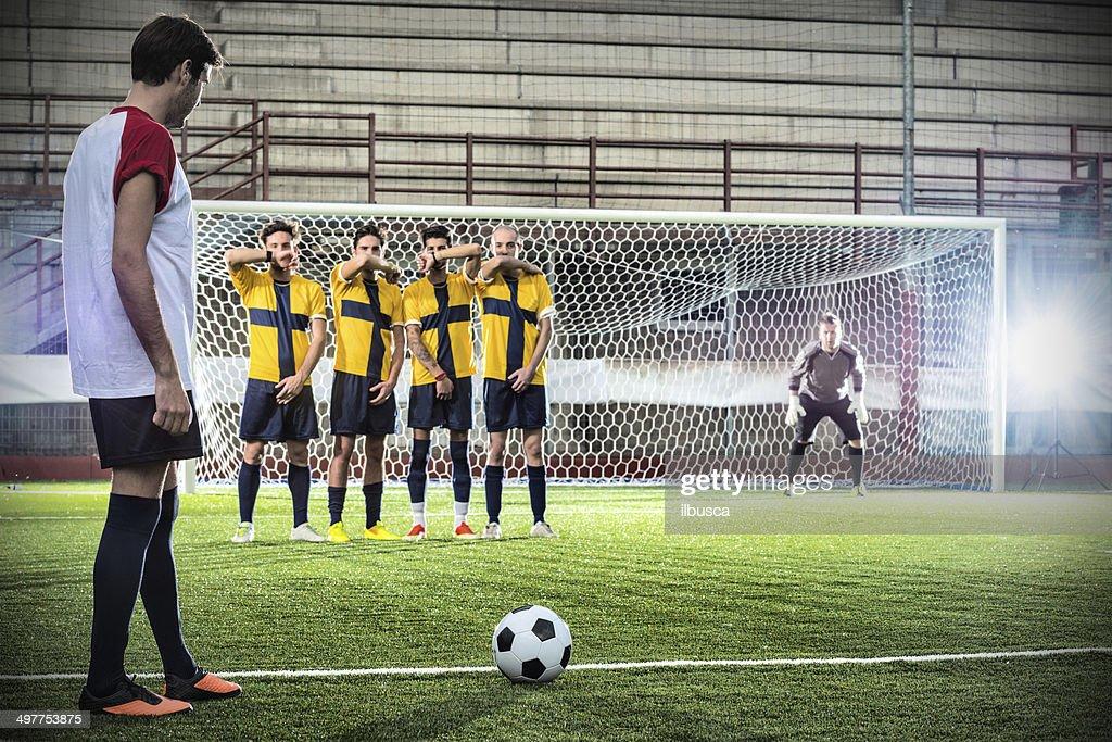 Football match in stadium: Free kick