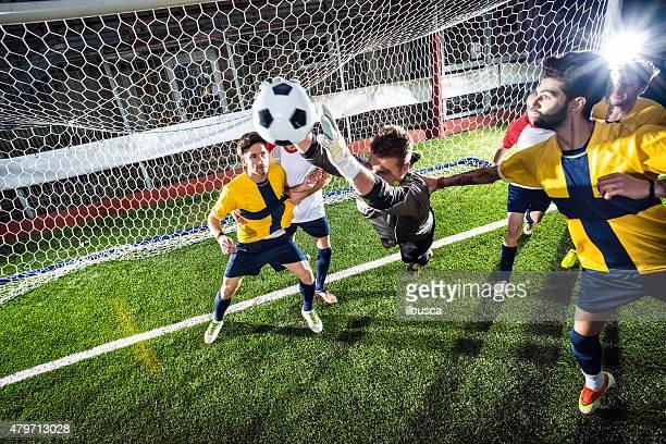 Football match in stadium: Goalkeeper save