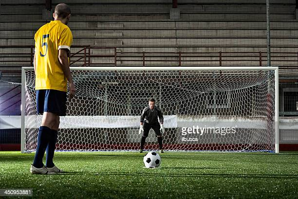 Football match in stadium: Penalty kick