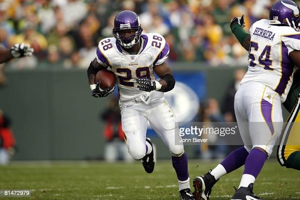 Football Minnesota Vikings Adrian Peterson in action rushing vs Green Bay Packers Green Bay WI