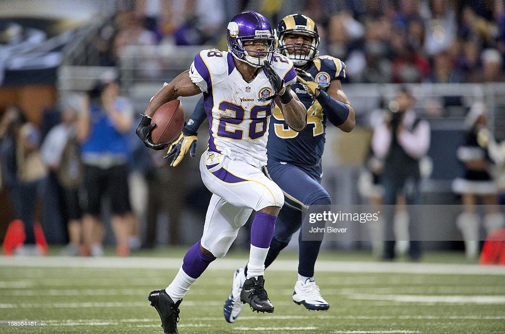Minnesota Vikings Adrian Peterson (28) in action, rushing vs St. Louis Rams at Edward Jones Dome. Cover. John Biever F124 )