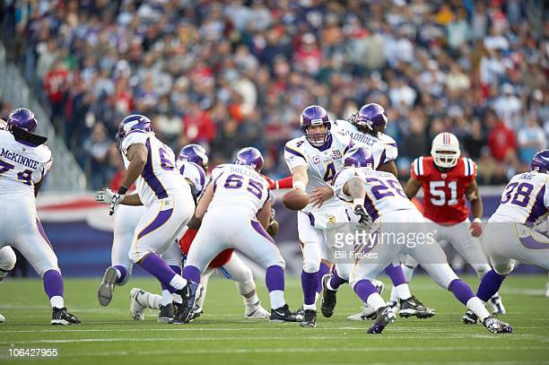 Minnesota Vikings QB Brett Favre in action handing off to Adrian Peterson vs New England Patriots Foxborough MA CREDIT Bill Frakes