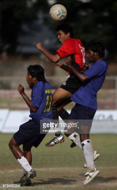 Football Mohammed Rafi of Mahindra United towers over two Union Bank of India defenders during their Elite Group B match on Monday at Cooperage