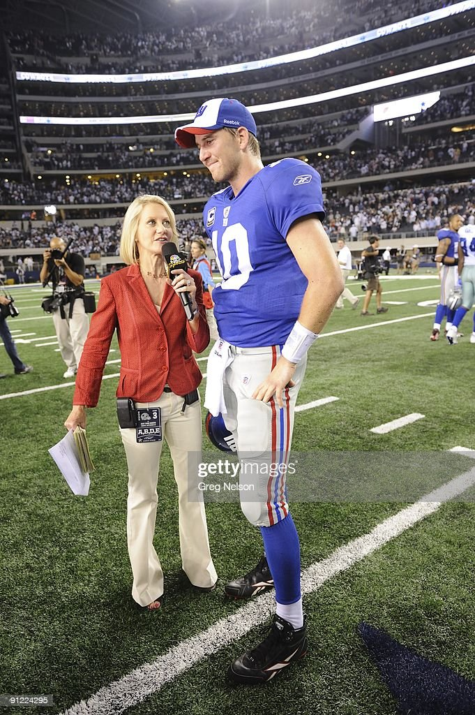 NBC Sports sideline reporter Andrea Kremer with New York Giants QB Eli Manning (10) after game vs Dallas Cowboys. Arlington, TX 9/20/2009