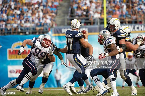 New England Patriots Mike Wright and Shawn Crable in action vs San Diego Chargers Phillip Rivers San Diego CA CREDIT John W McDonough