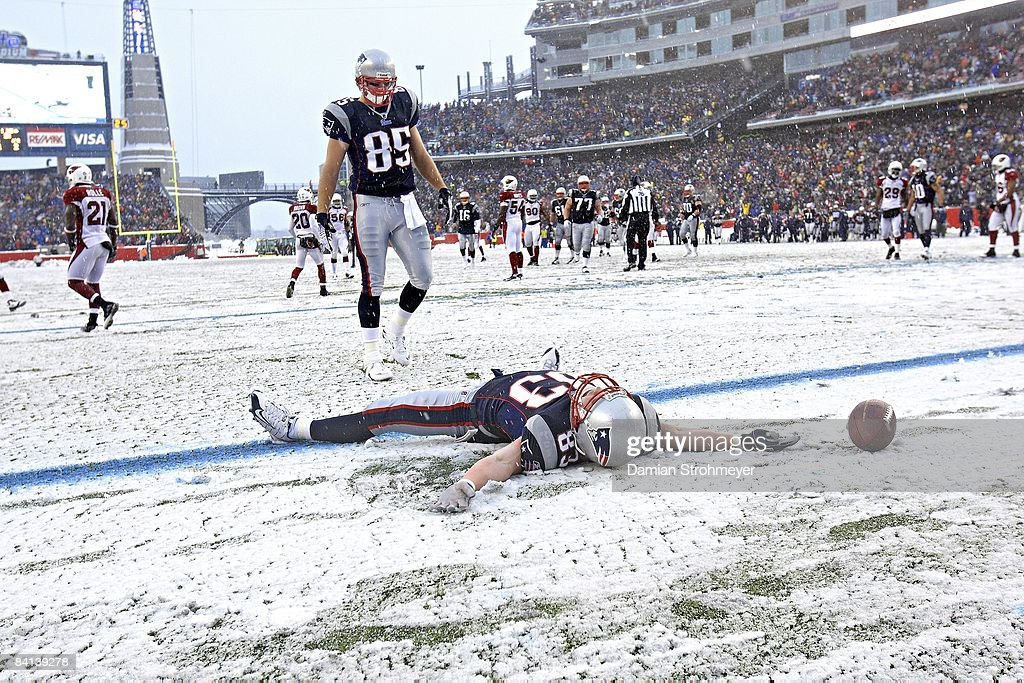 New England Patriots <a gi-track='captionPersonalityLinkClicked' href=/galleries/search?phrase=Wes+Welker&family=editorial&specificpeople=236127 ng-click='$event.stopPropagation()'>Wes Welker</a> (83) victorious, making snow angels in endzone after scoring touchdown vs Arizona Cardinals during 1st half. Foxboro, MA