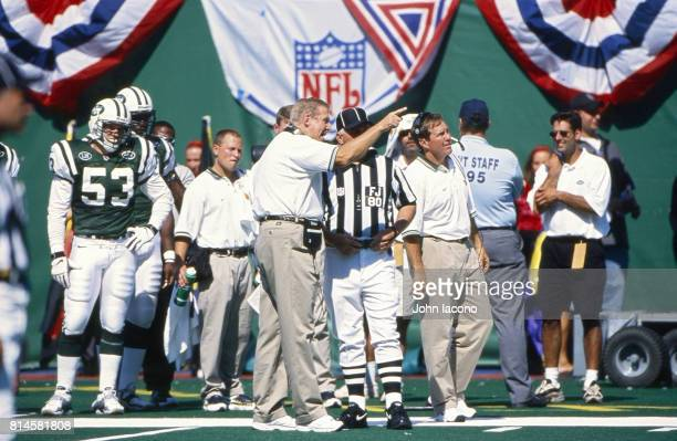 New York Jets coach Bill Parcells on sidelines arguing with referee with assistant coach Bill Belichick during game vs New England Patriots at Giants...
