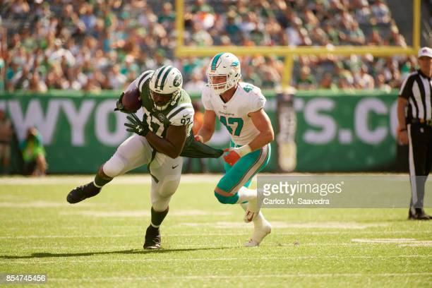 New York Jets Lawrence Thomas in action after making catch vs Miami Dolphins Kiko Alonso at MetLife Stadium East Rutherford NJ CREDIT Carlos M...