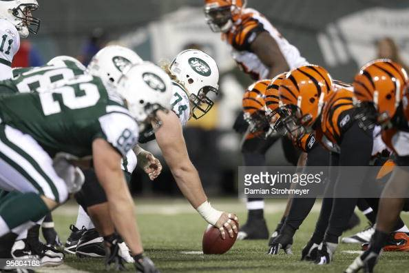 New York Jets Nick Mangold with ball vs Cincinnati Bengals defense at line of scrimmage East Rutherford NJ 1/3/2010 CREDIT Damian Strohmeyer