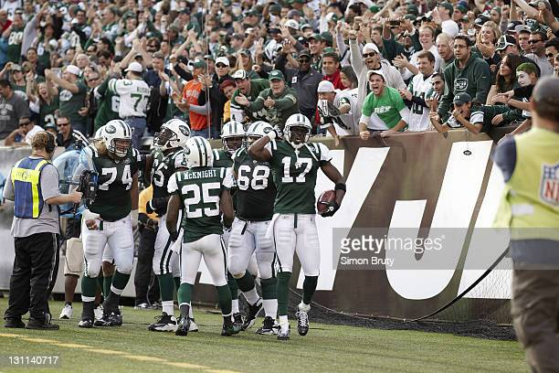 New York Jets Plaxico Burress victorious after scoring touchdown vs San Diego Chargers at MetLife Stadium East Rutherford NJ CREDIT Simon Bruty