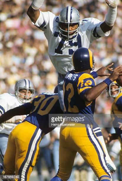 NFC Championship Dallas Cowboys Harvey Martin in action defense vs Los Angeles Rams QB James Harris at Los Angeles Memorial Coliseum Los Angeles CA...