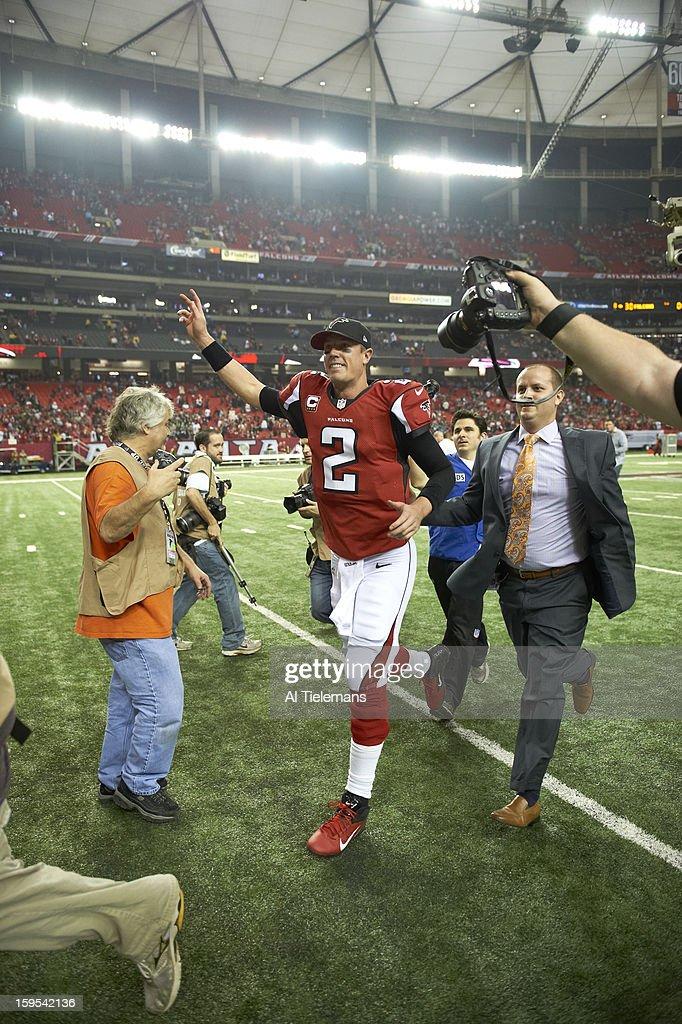 Atlanta Falcons QB Matt Ryan (2) victorious on field after winning game vs Seattle Seahawks at Georgia Dome. Al Tielemans F82 )