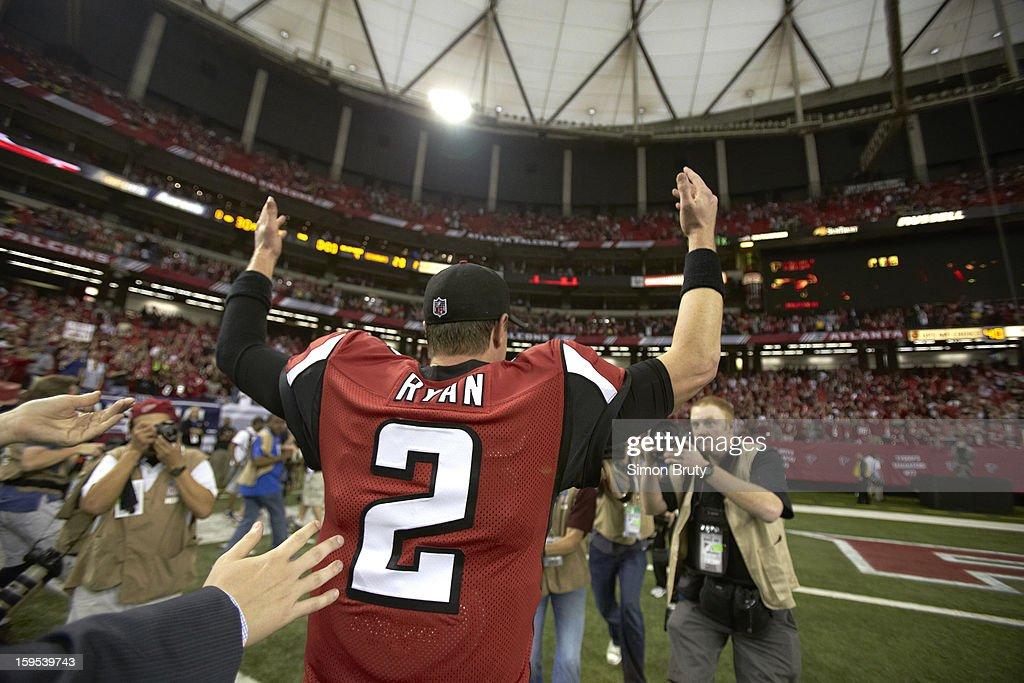 Closeup from rear of Atlanta Falcons QB Matt Ryan (2) victorious on field after winning game vs Seattle Seahawks at Georgia Dome. Simon Bruty F119 )