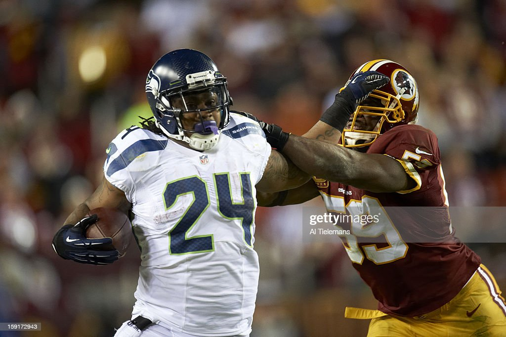 Closeup of Seattle Seahawks Marshawn Lynch (24) in action, stiff arm vs Washington Redskins London Fletcher (59) at FedEx Field. Al Tielemans F230 )