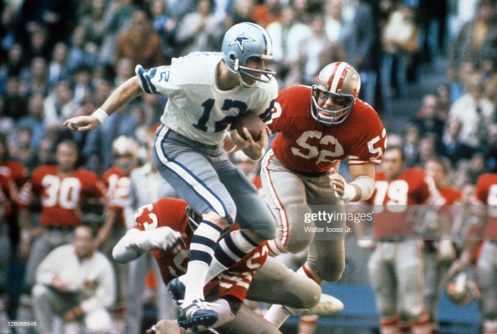 Dallas Cowboys QB Roger Staubach (12) in action vs San Francisco 49ers Skip Vanderbundt (52) at Texas Staduim. Walter Iooss Jr. X16462 )