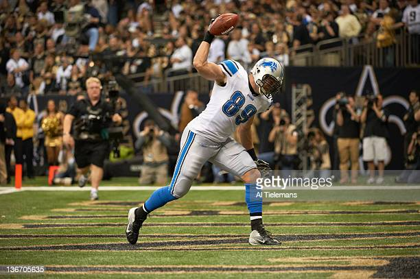NFC Playoffs Detroit Lions Will Heller victorious spiking ball after scoring touchdown vs New Orleans Saints at MercedesBenz Superdome New Orleans LA...