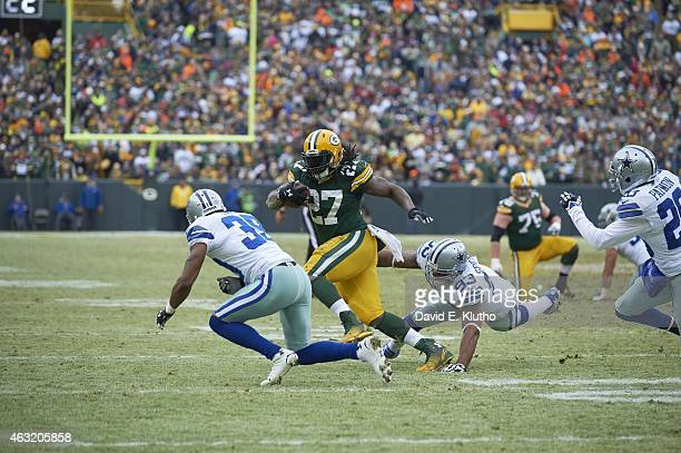 NFC Playoffs Green Bay Packers Eddie Lacy in action rushing vs Dallas Cowboys Anthony Spencer and CB Brandon Carr at Lambeau Field Green Bay WI...