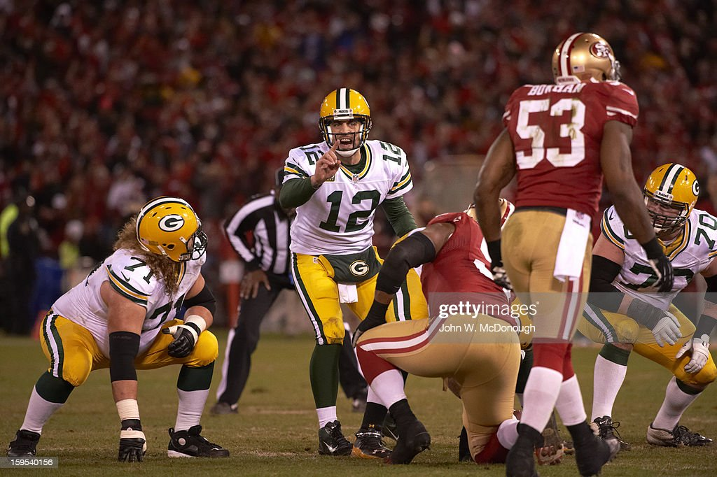Green Bay Packers QB Aaron Rodgers (12) calling signals during game vs San Francisco 49ers at Candlestick Park. John W. McDonough F436 )
