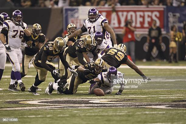 NFC Playoffs Minnesota Vikings Adrian Peterson in action making fumble vs New Orleans Saints Jonathan Vilma Peterson and Vilma chasing fumble New...