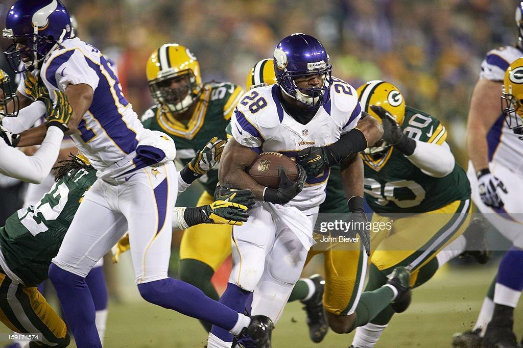Minnesota Vikings Adrian Peterson (28) in action, rushing vs Green Bay Packers B.J. Raji (90) at Lambeau Field. John Biever F35 )