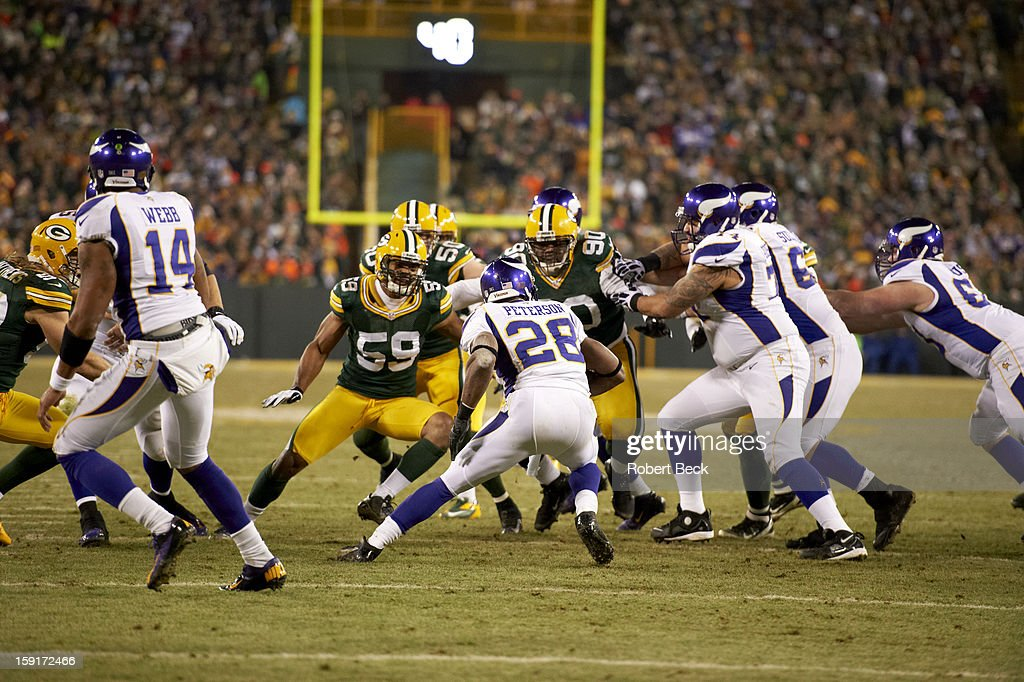 Rear view of Minnesota Vikings Adrian Peterson (28) in action, rushing vs Green Bay Packers Brad Jones (59) and B.J. Raji (90) at Lambeau Field. Robert Beck F156 )
