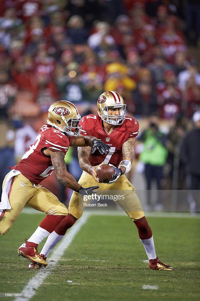 San Francisco 49ers QB Colin Kaepernick (7) in action, handoff to LaMichael James (23) vs Green Bay Packers at Candlestick Park. Robert Beck F166 )