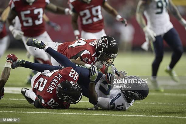 NFC Playoffs Seattle Seahawks Devin Hester in action vs Atlanta Falcons Eric Weems and Joshua Perkins at Georgia Dome Atlanta GA CREDIT Simon Bruty