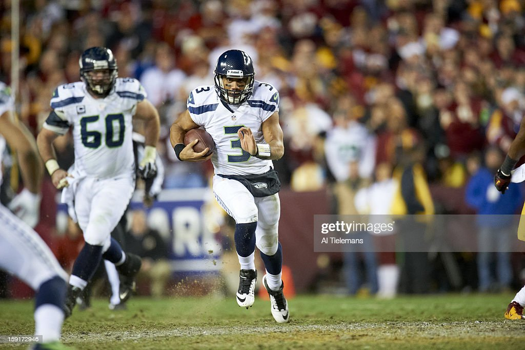 Seattle Seahawks QB Russell Wilson (3) in action, rushing vs Washington Redskins at FedEx Field. Al Tielemans F299 )
