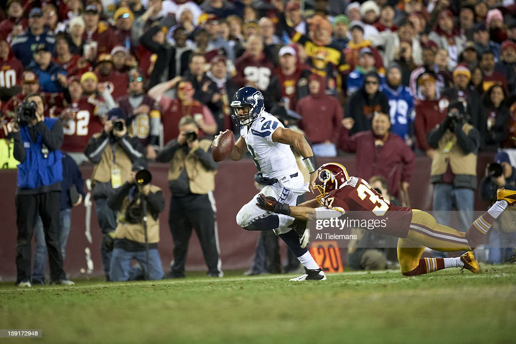 Seattle Seahawks QB Russell Wilson (3) in action, rushing vs Washington Redskins at FedEx Field. Al Tielemans F340 )
