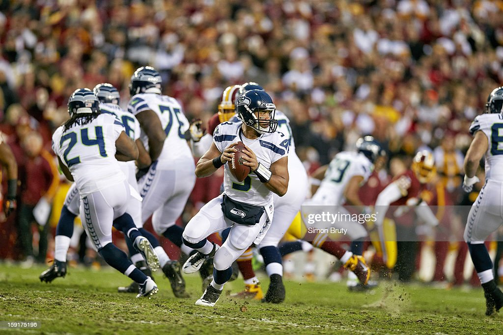 Seattle Seahawks QB Russell Wilson (3) in action vs Washington Redskins at FedEx Field. Simon Bruty F196 )