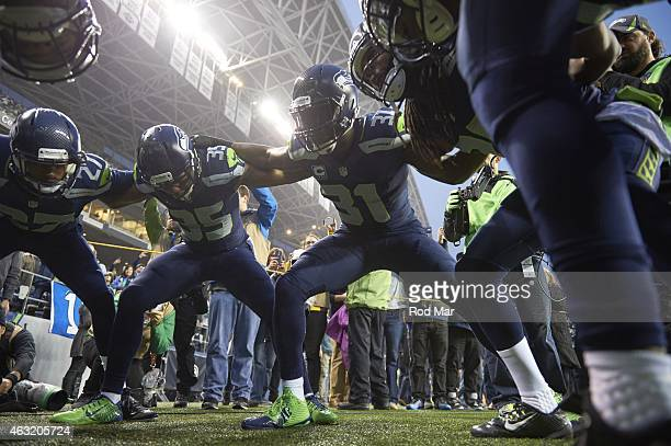 NFC Playoffs Seattle Seahawks Tharold Simon Kam Chancellor and DeShawn Shead in huddle before game vs Carolina Panthers at CenturyLink Field Seattle...