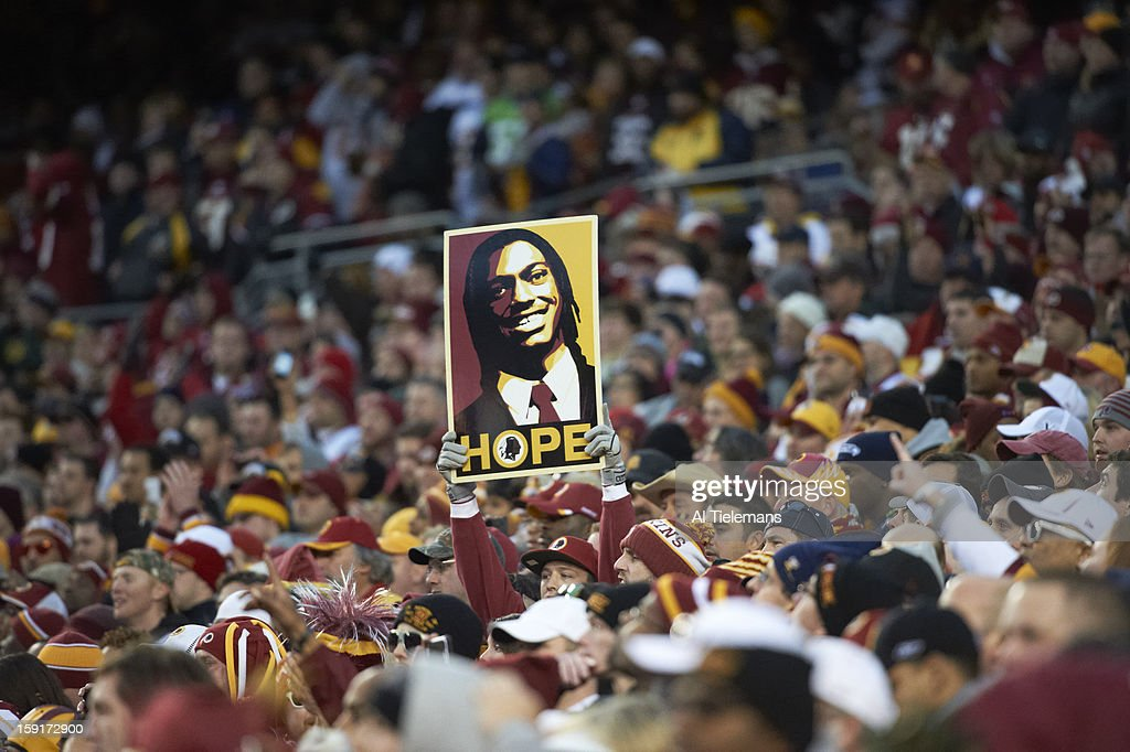 View of Washington Redskins fans holding signs during game vs Seattle Seahawks at FedEx Field. Al Tielemans F101 )