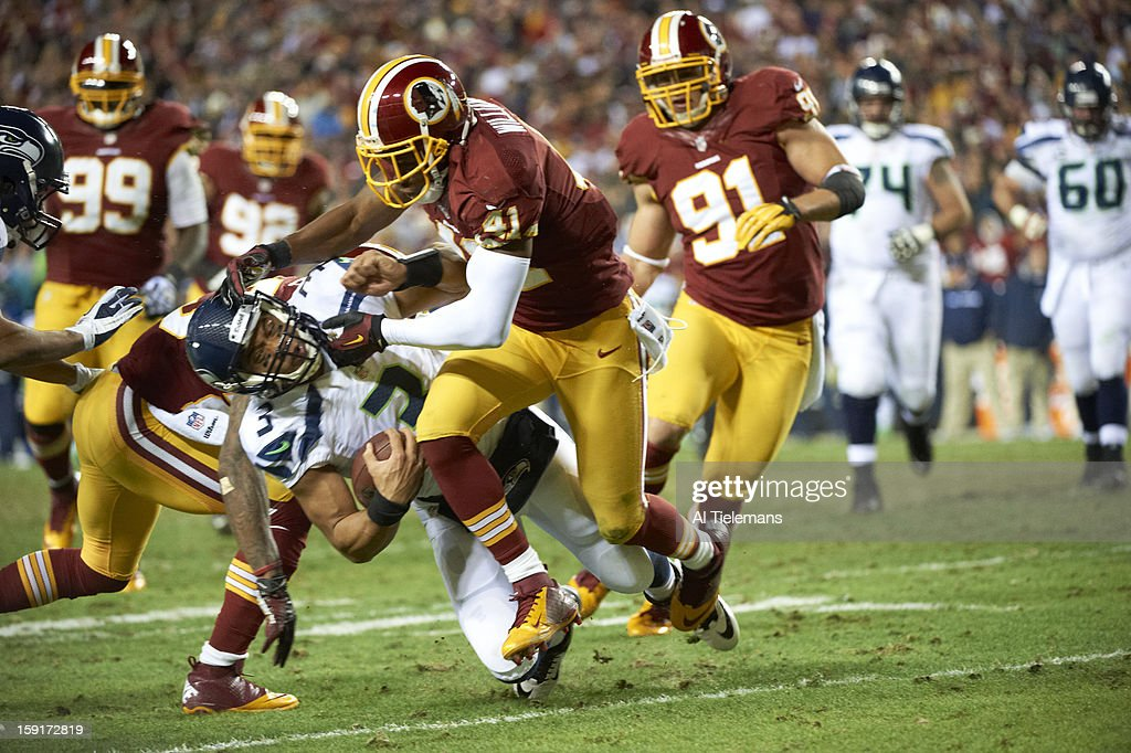 Washington Redskins Madieu Williams (41) in action, tackle vs Seattle Seahawks QB Russell Wilson (3) at FedEx Field. Al Tielemans F94 )