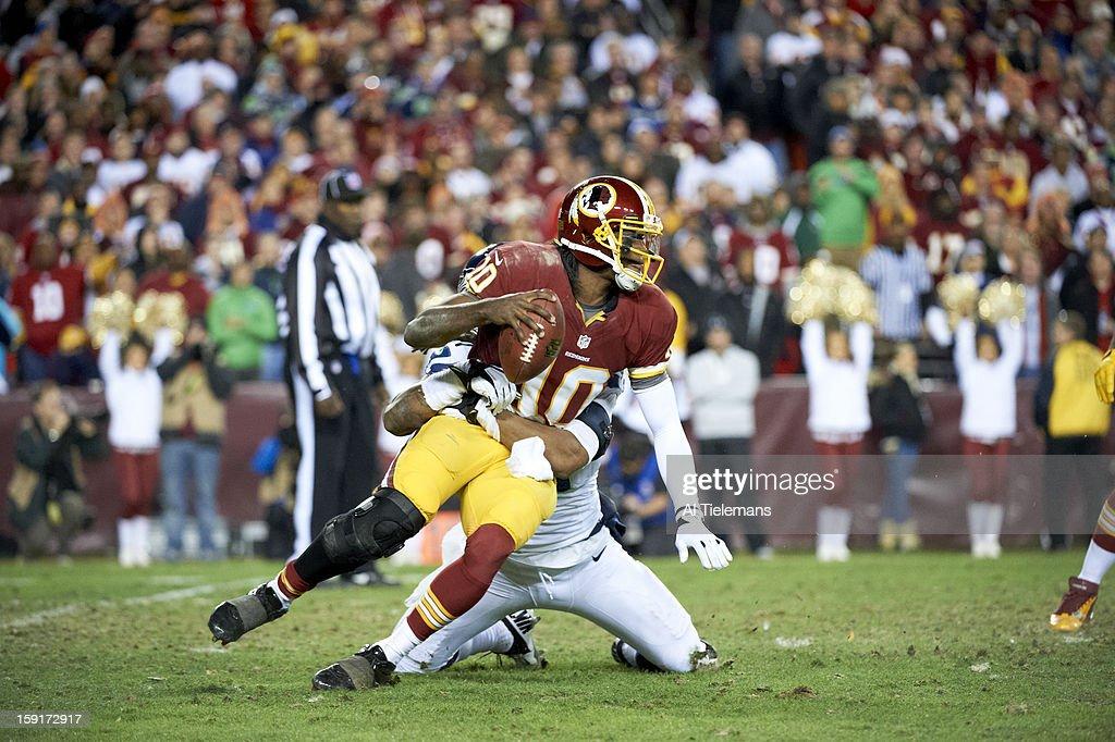 Washington Redskins QB Robert Griffin III (10) in action under pressure vs Seattle Seahawks Bruce Irvin (51) at FedEx Field. Sequence. Al Tielemans F425 )
