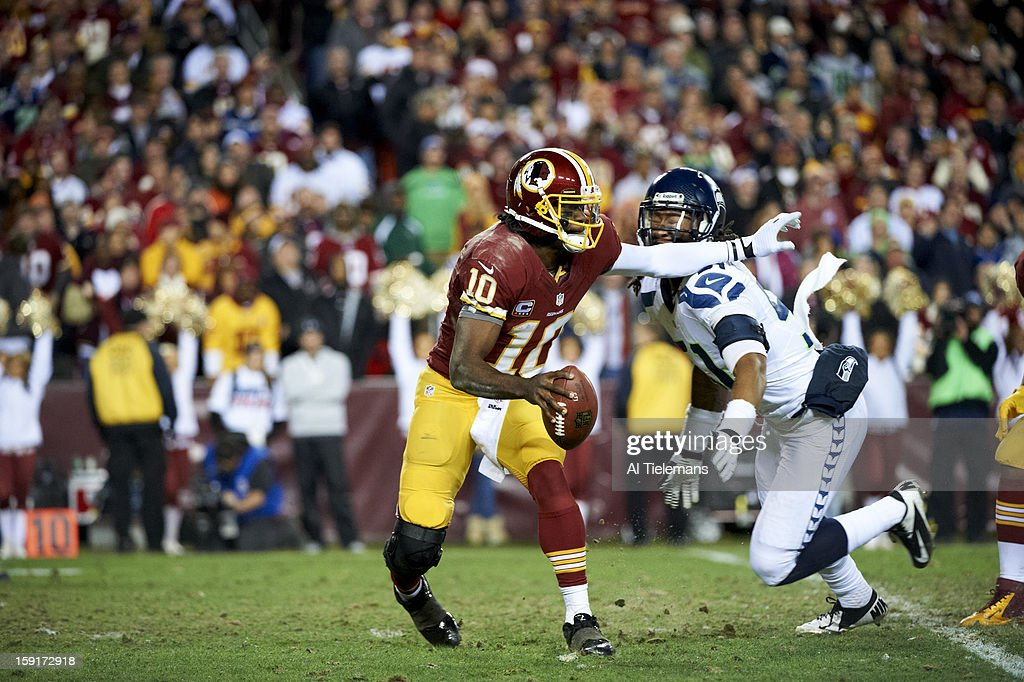 Washington Redskins QB Robert Griffin III (10) in action under pressure vs Seattle Seahawks Bruce Irvin (51) at FedEx Field. Sequence. Al Tielemans F420 )