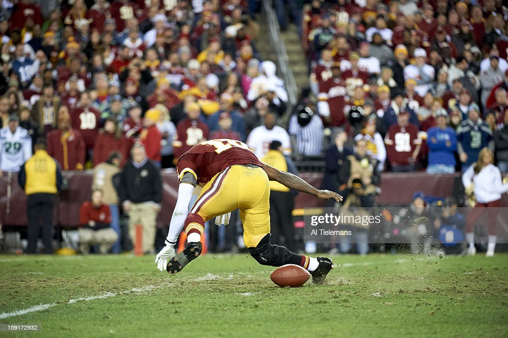 Washington Redskins QB Robert Griffin III (10) in action vs Seattle Seahawks at FedEx Field. Griffin injured his knee on the play. Al Tielemans F450 )
