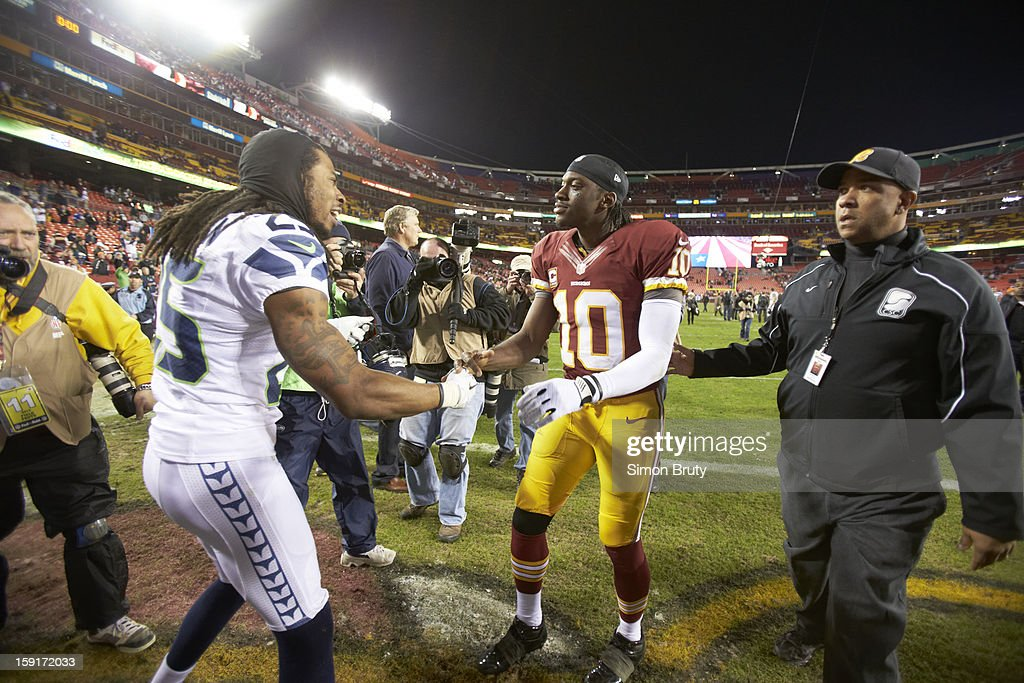 Washington Redskins QB Robert Griffin III (10) congratulating Seattle Seahawks Richard Sherman (25) on field after game at FedEx Field. Simon Bruty F146 )