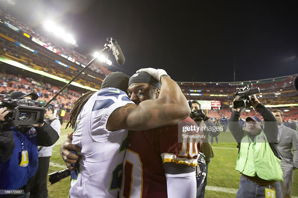 Washington Redskins QB Robert Griffin III (10) congratulating Seattle Seahawks Richard Sherman (25) on field after game at FedEx Field. Simon Bruty F165 )