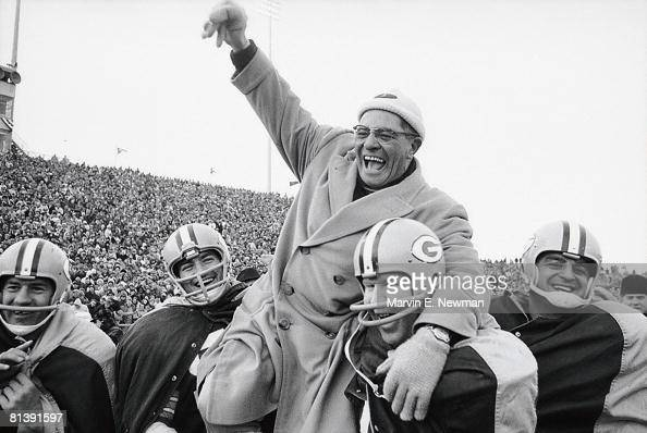Football NFL championship Green Bay Packers coach Vince Lombardi victorious getting carried off field by team after winning game vs New York Giants...