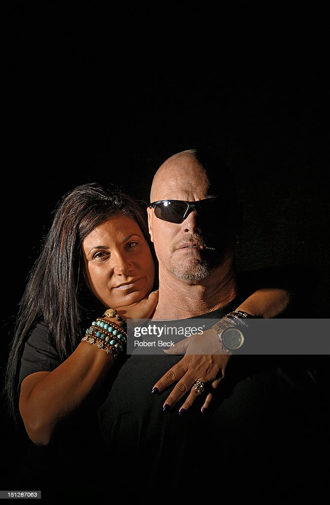 Closeup portrait of retired NFL player Jim McMahon and girlfriend Laurie Navon in studio during photo shoot. McMahon has been diagnosed early dementia. Cover. Robert Beck F64 )