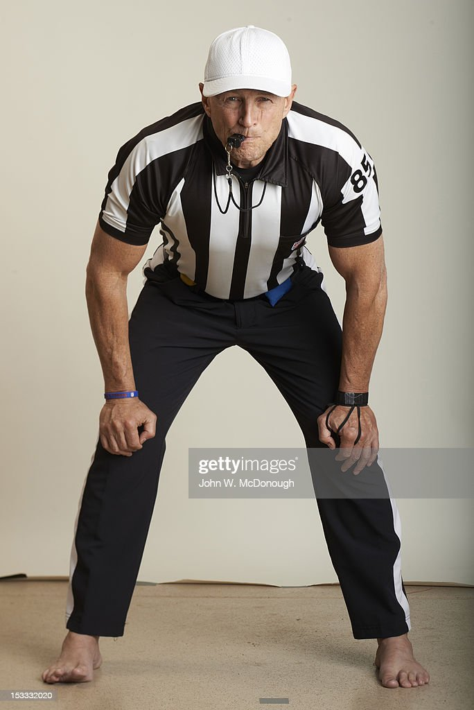Portrait of NFL referee Ed Hochuli (85) gesturing the chop block signal while posing during photo shoot at his home. Cover. John W. McDonough F75 )