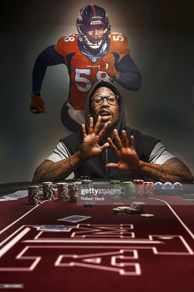 NFL Season Preview Casual portrait of Denver Broncos linebacker Von Miller posing at poker table during photo shoot at home View of mural of Miller...