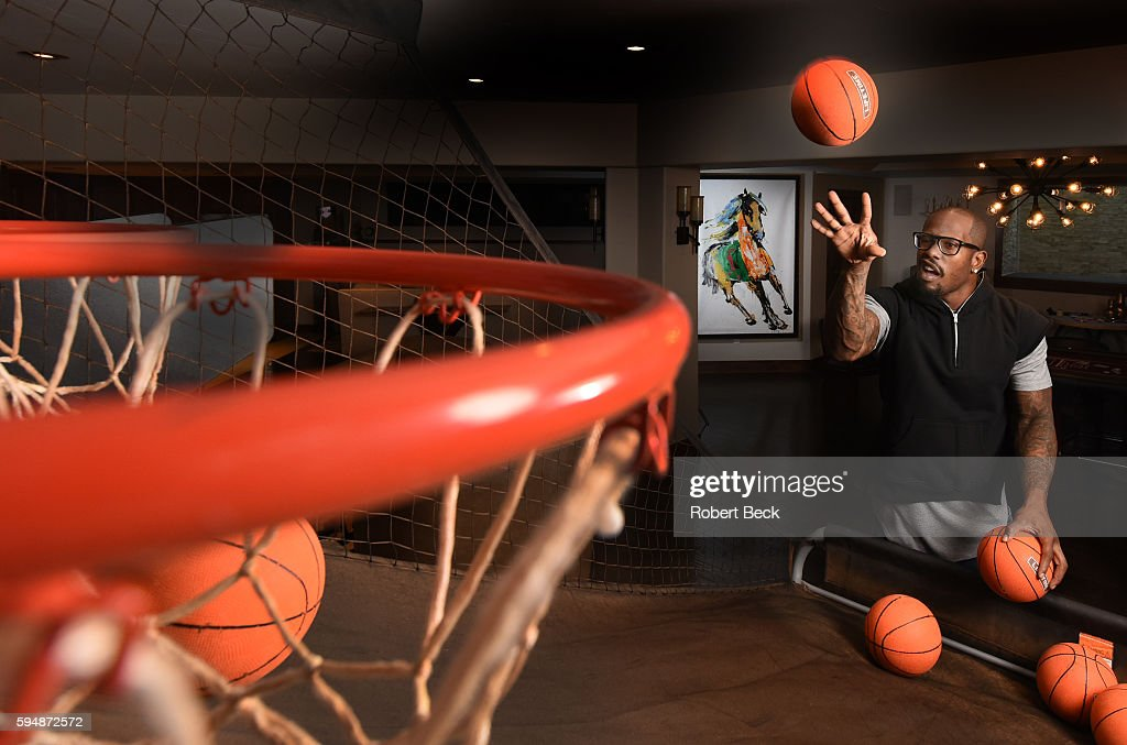 NFL Season Preview Casual portrait of Denver Broncos linebacker Von Miller shooting miniature basketballs during photo shoot at home Foxfield CO...