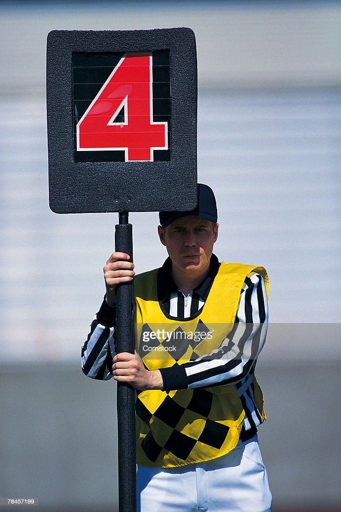 Football official holding fourth down marker