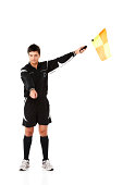 Football official signals a penalty on white