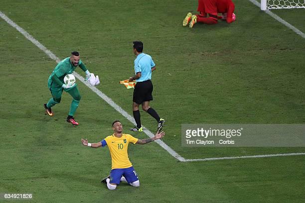 Day 15 Neymar of Brazil in tears after scoring the winning penalty kick as team mate goalkeeper Weverton celebrates with Neymar as German goalkeeper...